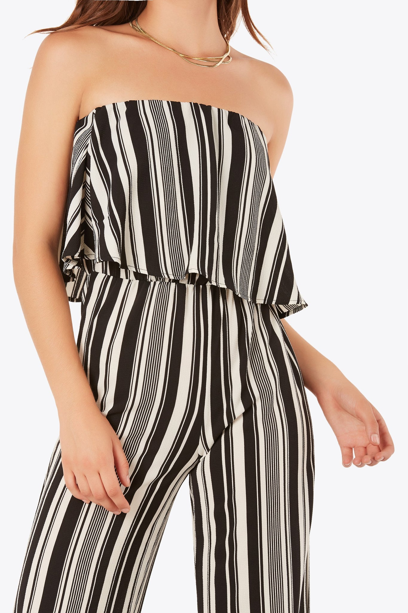 Strapless tube jumpsuit with bold stripe pattern throughout. Simple tiered design with wide leg fit.