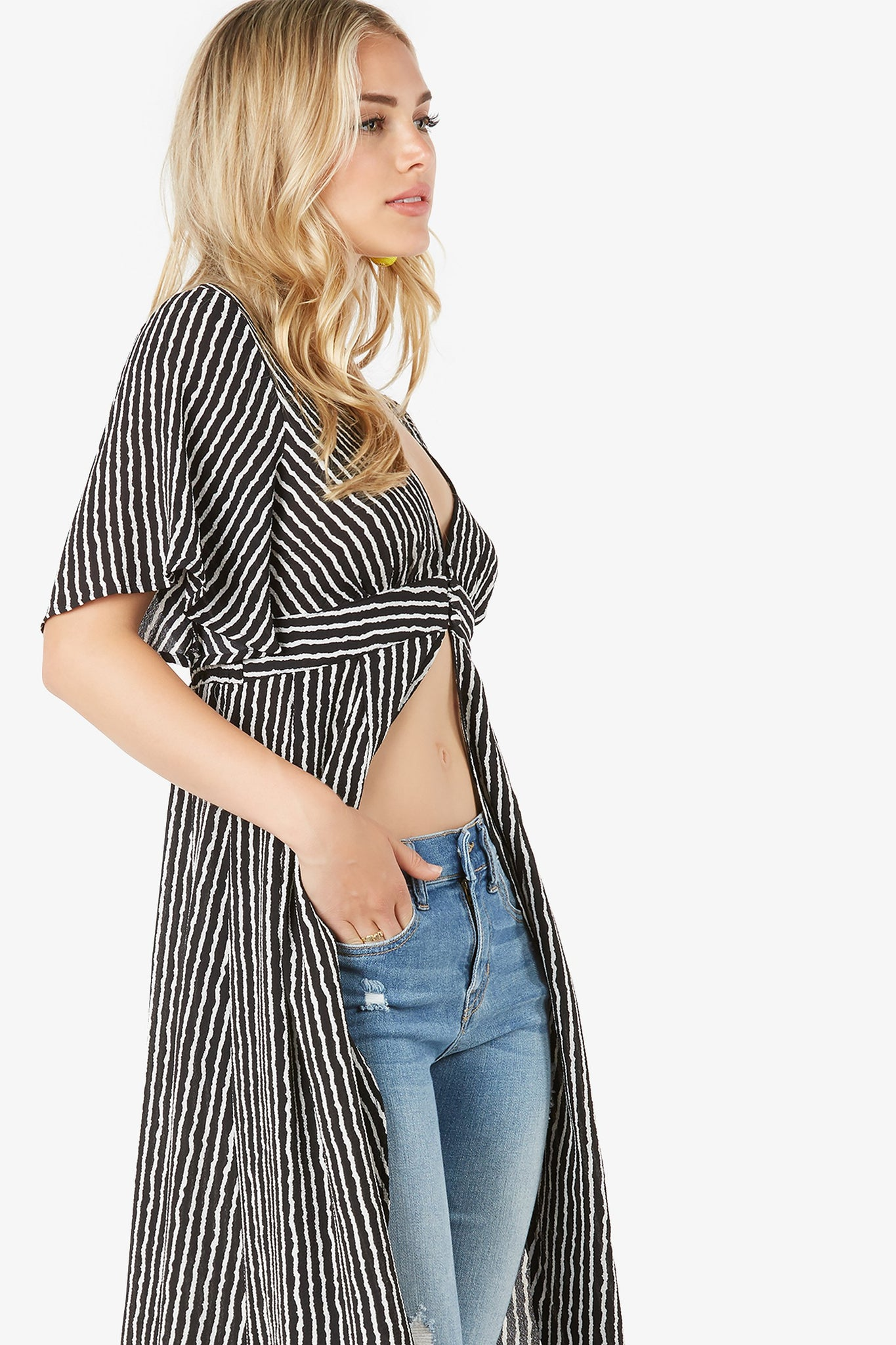 Chic short sleeve kimono top with V-neckline. Dainty button closure in front with flowy longline hem finish.