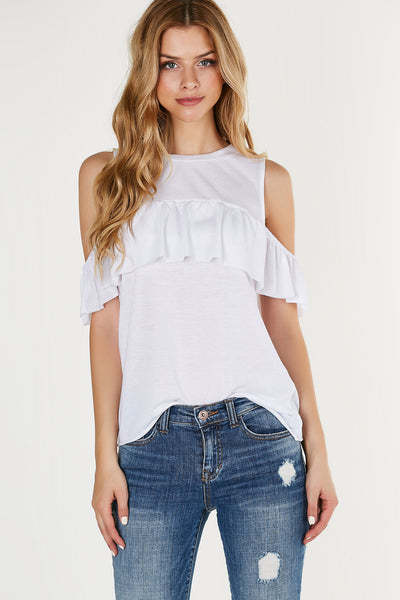 Crew neck top with flirty ruffle detailing and cold shoulder cut outs. Relaxed fit with raw cut hem all around.