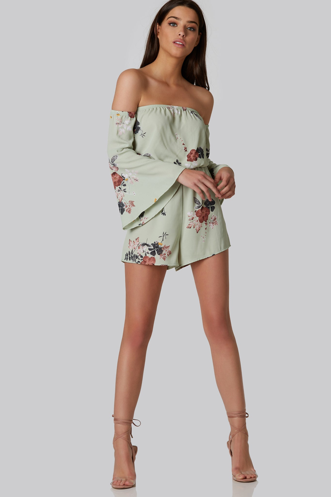 Lightweight floral printed romper with cold shoulder cut outs and bell sleeves. Flowy fit with elastic bands for comfort and fit.