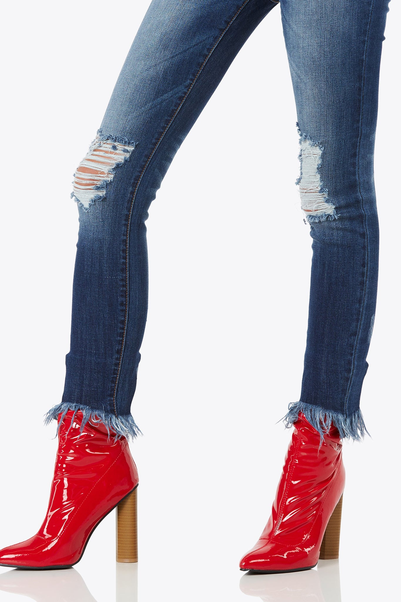 Enjoy the flexible fit classic skinny jean with distressed accents on legs and hem.