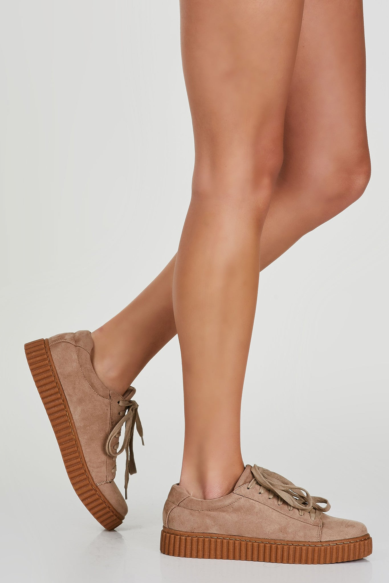 Classic creeper style sneakers with soft suede finish. Contrast platform soles with lace up finish for closure and fit.