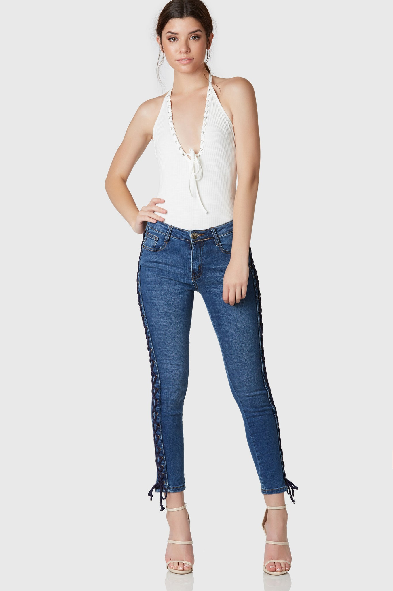 Classic pair of blue jeans with comfortable stretchy fit. 5 pocket design with button and zip closure. Trendy lace up detailing on each side.