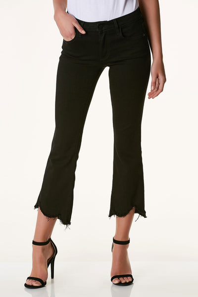 Mid rise jeans with a slight flare. Cropped, uneven hem with raw finish.