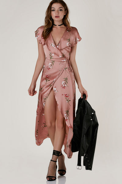 Gorgeous satin wrap dress with ruffled cap sleeves and flowy hi-low hem. Delicate floral print throughout with ties for closure.