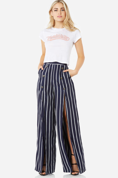 Bold high rise pants with stripe pattern throughout. Faux buttons and high slit design with back zip closure.