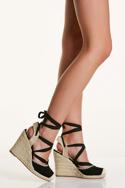 Chic espadrille wedges with soft suede finish and comfortable back strap. Lace up design with rounded toe finish.