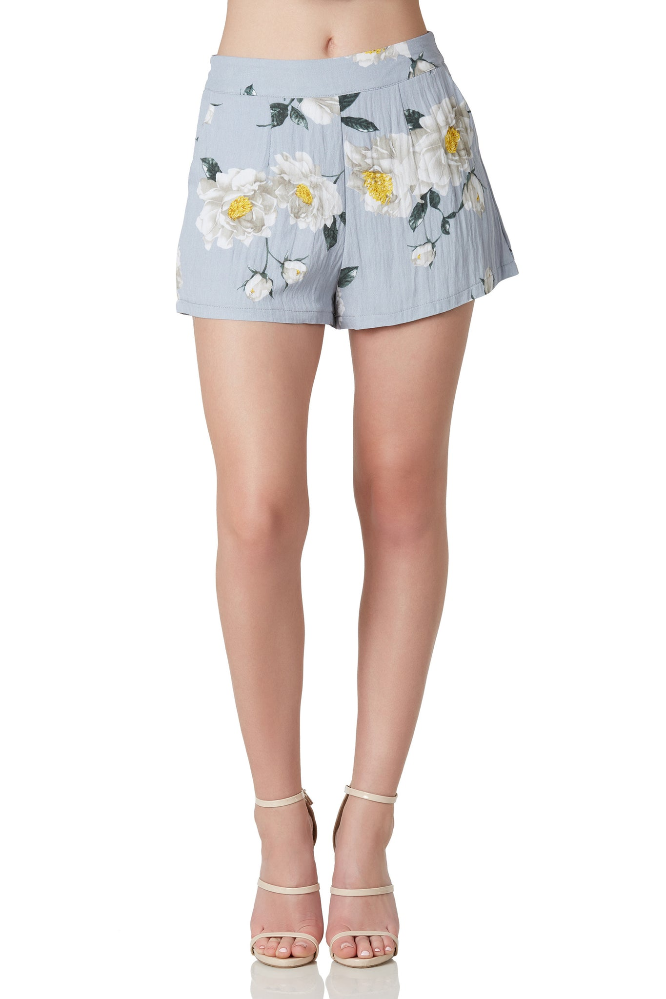 Fully lined high rise shorts with floral patterns throughout. Side pockets with back zip closure.