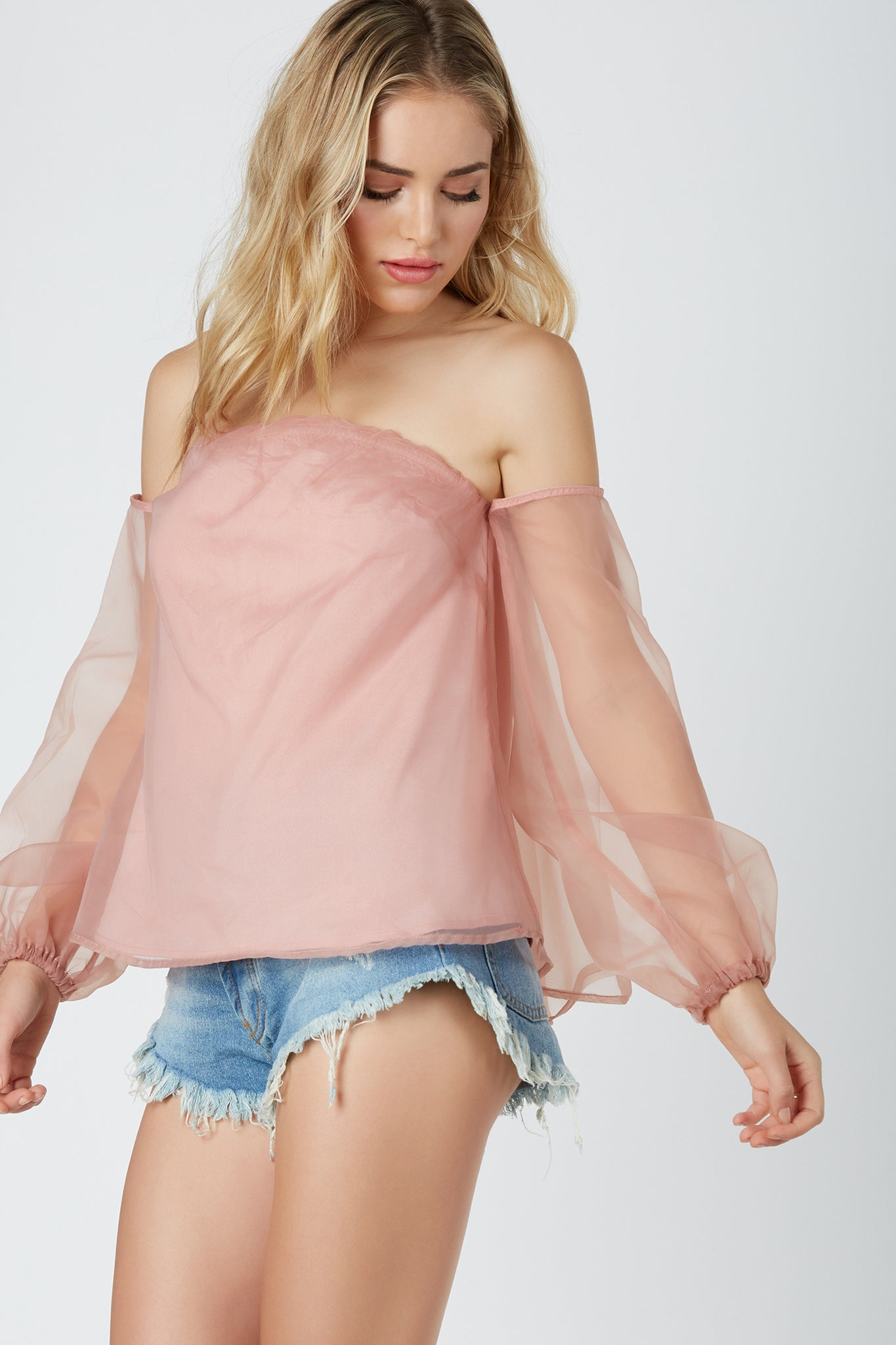 Chic off shoulder blouse with elasticized trim at top. Lined body with sheer chiffon overlay.