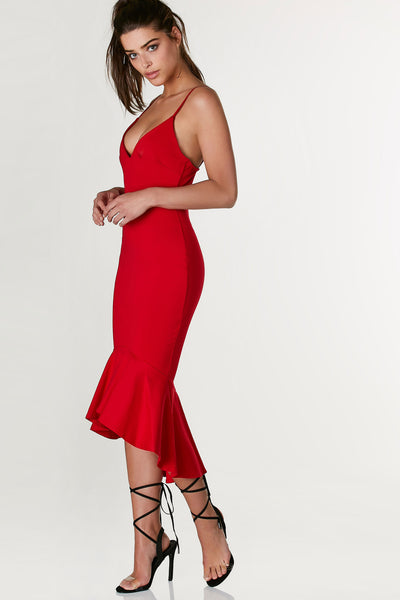 V neck spaghetti strap dress with bodycon fit. Ruffle flared hi low trim.