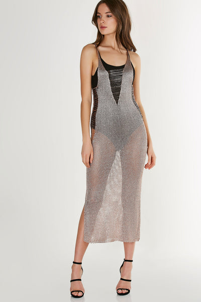 Sleeveless U-neck loose knit maxi dress with bold side slits. Metallic finish with straight hem all around.