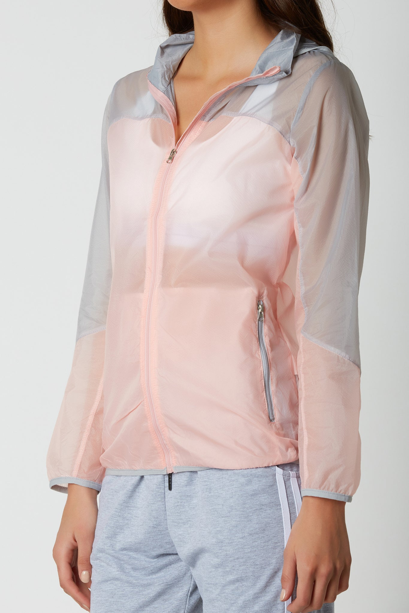 Trendy lightweight colorblock jacket, perfect for working out and rainy weather. Zip front closure with side pockets and straight hem finish.