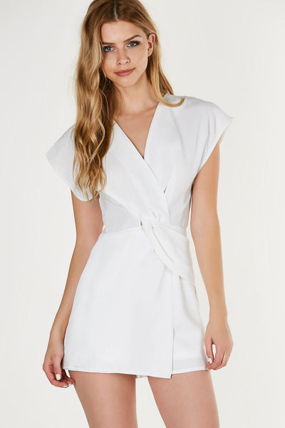 Chic cap sleeve romper with tunic style finish. Twisted knot design at center with back zip closure.