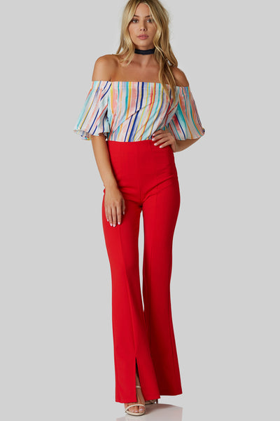 Colorful off shoulder top with oversized fit and stripe patterns throughout.