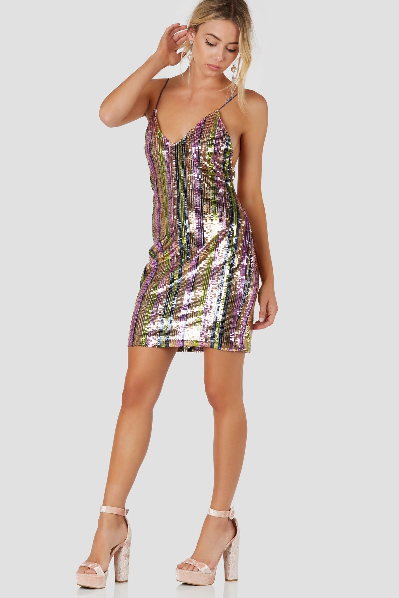 Bold spaghetti strap dress with colorful sequin exterior. V-neckline wtih straight hem finish.