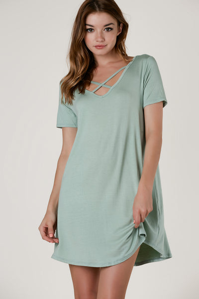 Casual short sleeve tunic dress with strappy detailing in both front and back. Soft material with flowy fit and A-line hem finish.