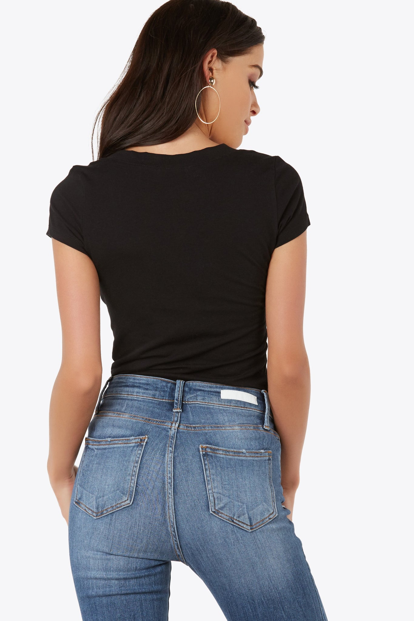 Add this staple top to any look, casual or chic. Short sleeve top with v-neckline.