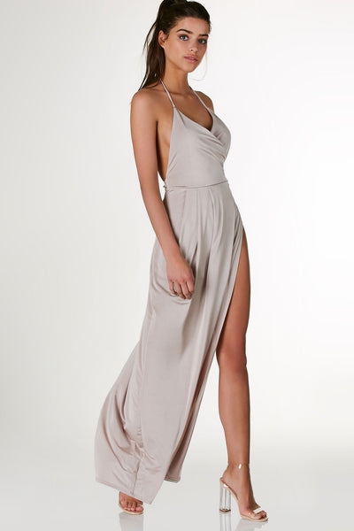 Stunning halter maxi dress with overlap neckline and sexy open back. Wrap style design with bold open side.