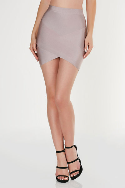 Mid rise mini skirt with bodycon fit. Bandage material with envelope style hem and back zip closure. Comes in a set with matching top sold separately.