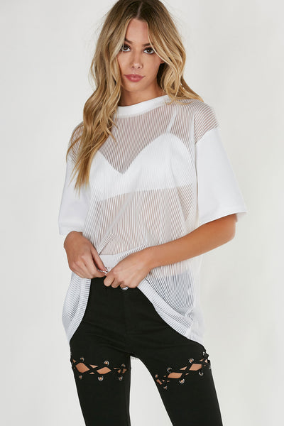 An oversized short sleeve top with trendy striped mesh body. Contrast sleeves and neckline. Comes with solid bralette underneath.