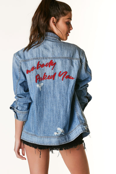 Trendy oversized denim jacket with embroidered detailing and distressing throughout. Vintage vibe with faded wash of denim