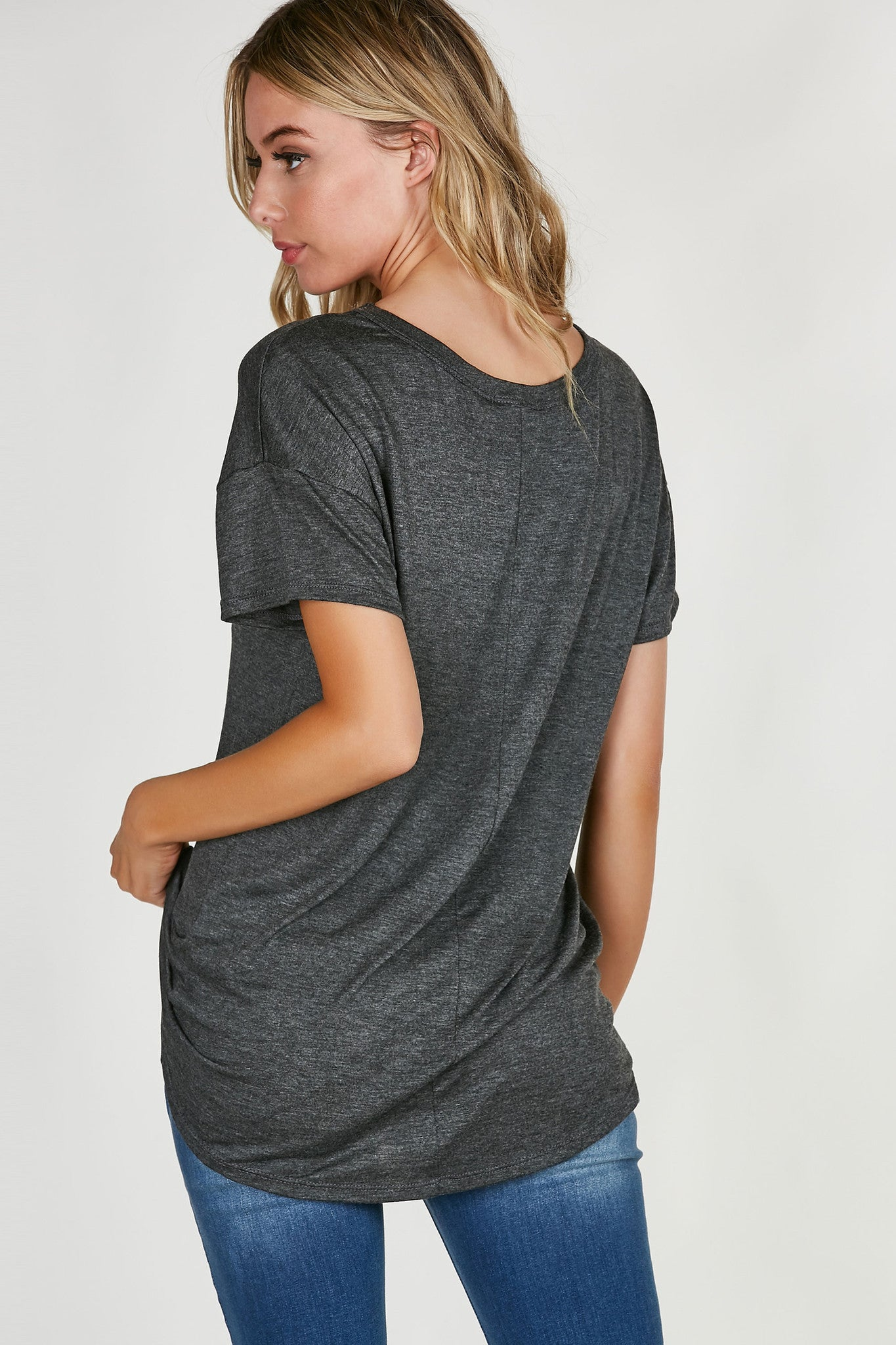 Soft V-neck tee with graphic in front. Hi-low hem with slightly oversized fit.