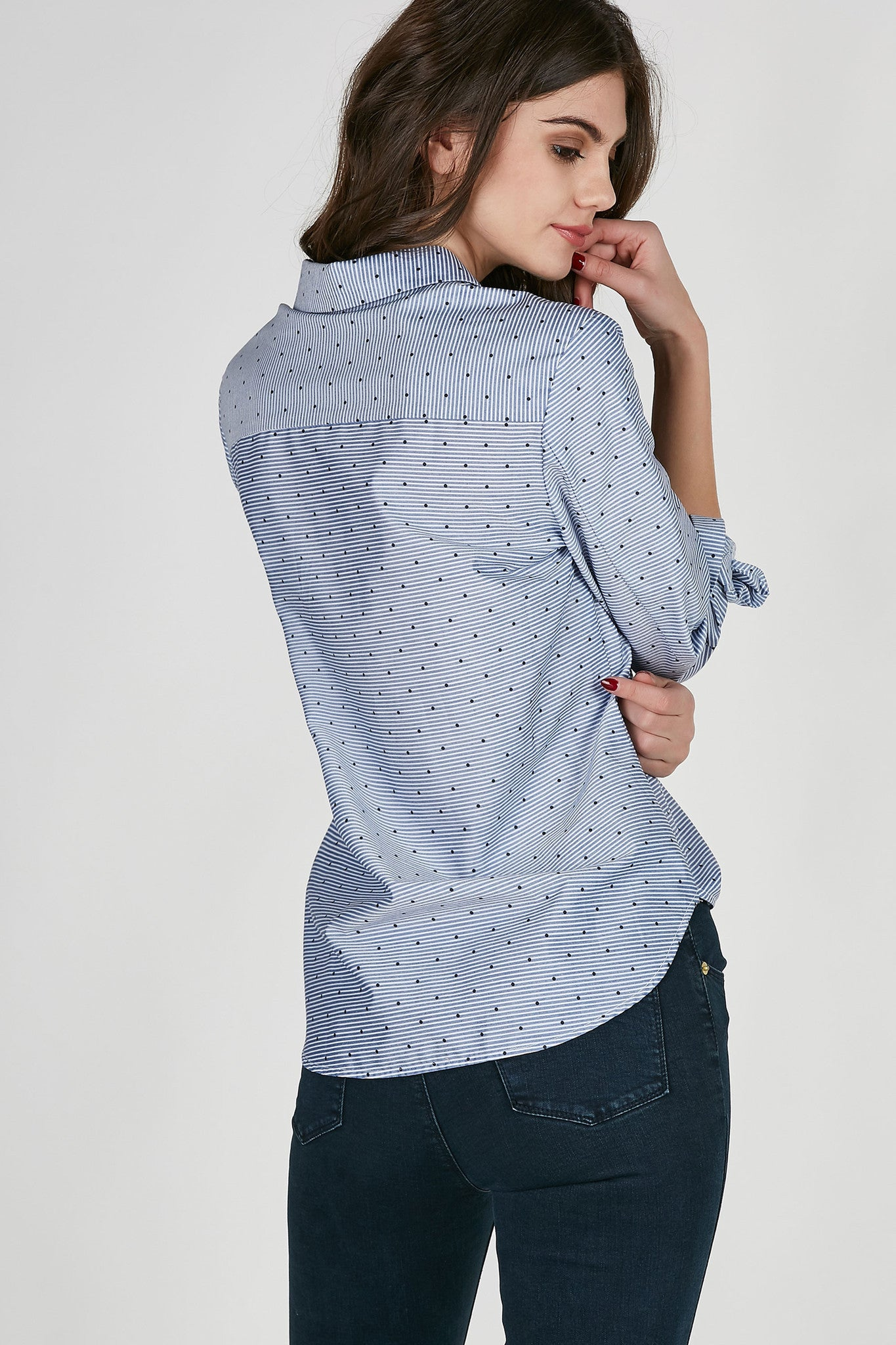 Oversized collared button down nautical stripes and polka dot patterns throughout. Long sleeves with rounded hem.