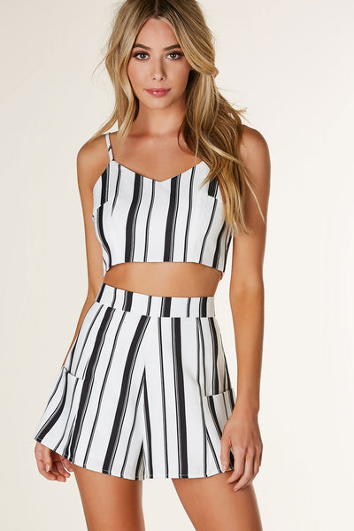 Chic striped crop top with adjustable spaghetti straps. Fully lined with exposed back zip closure.