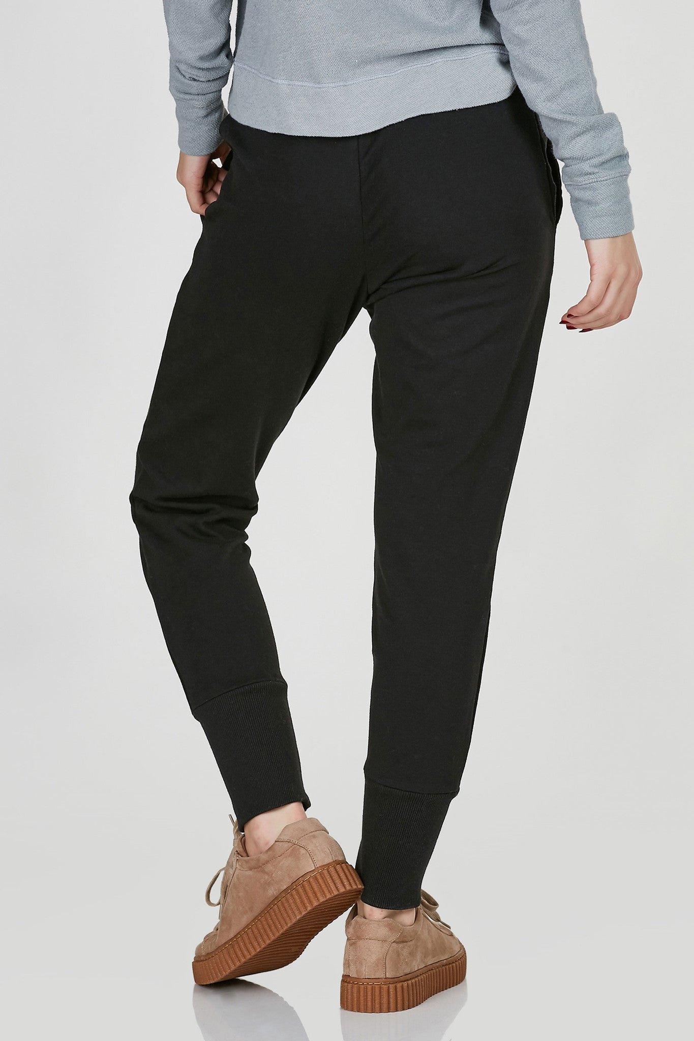 Mid rise jogger style sweatpants with trendy lace up closure at waist. Ribbed hem with relaxed fit.