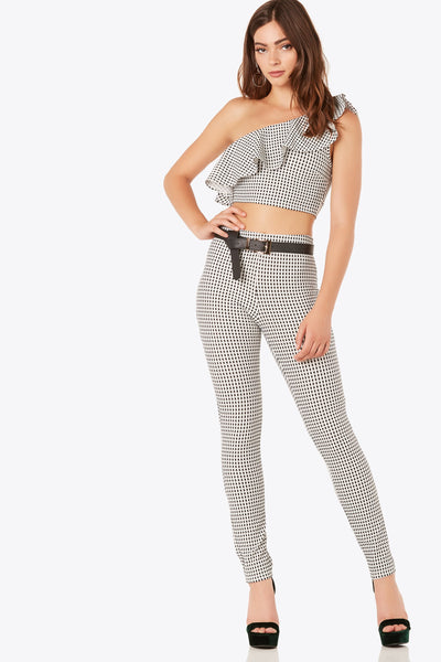 Chic high rise pants with grid print throughout. Stretchy slim fit with straight hem finish and back zip closure.