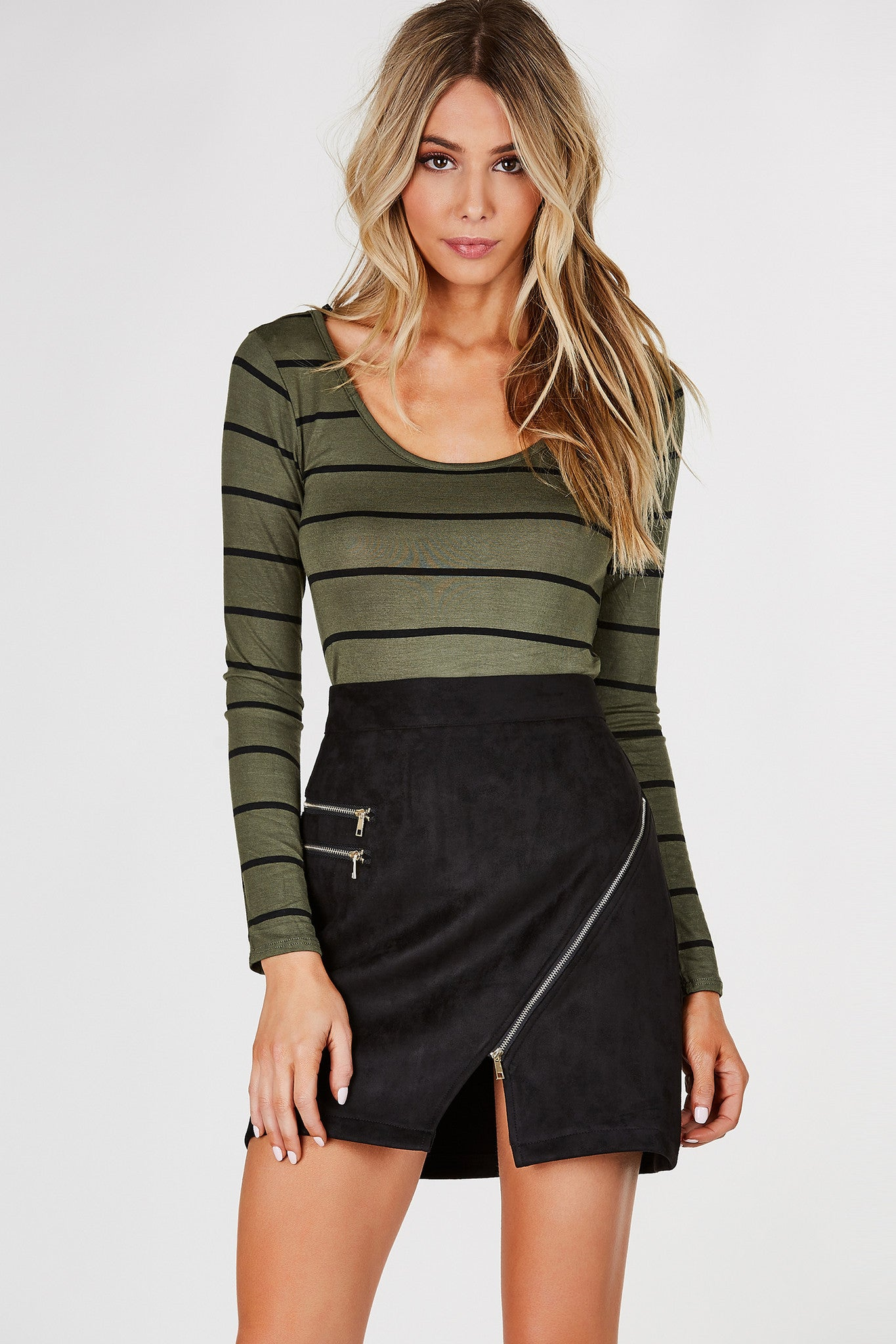 Round neck long sleeve top with stripe patterns through out. V-shape back with strappy detailing with rounded hem.