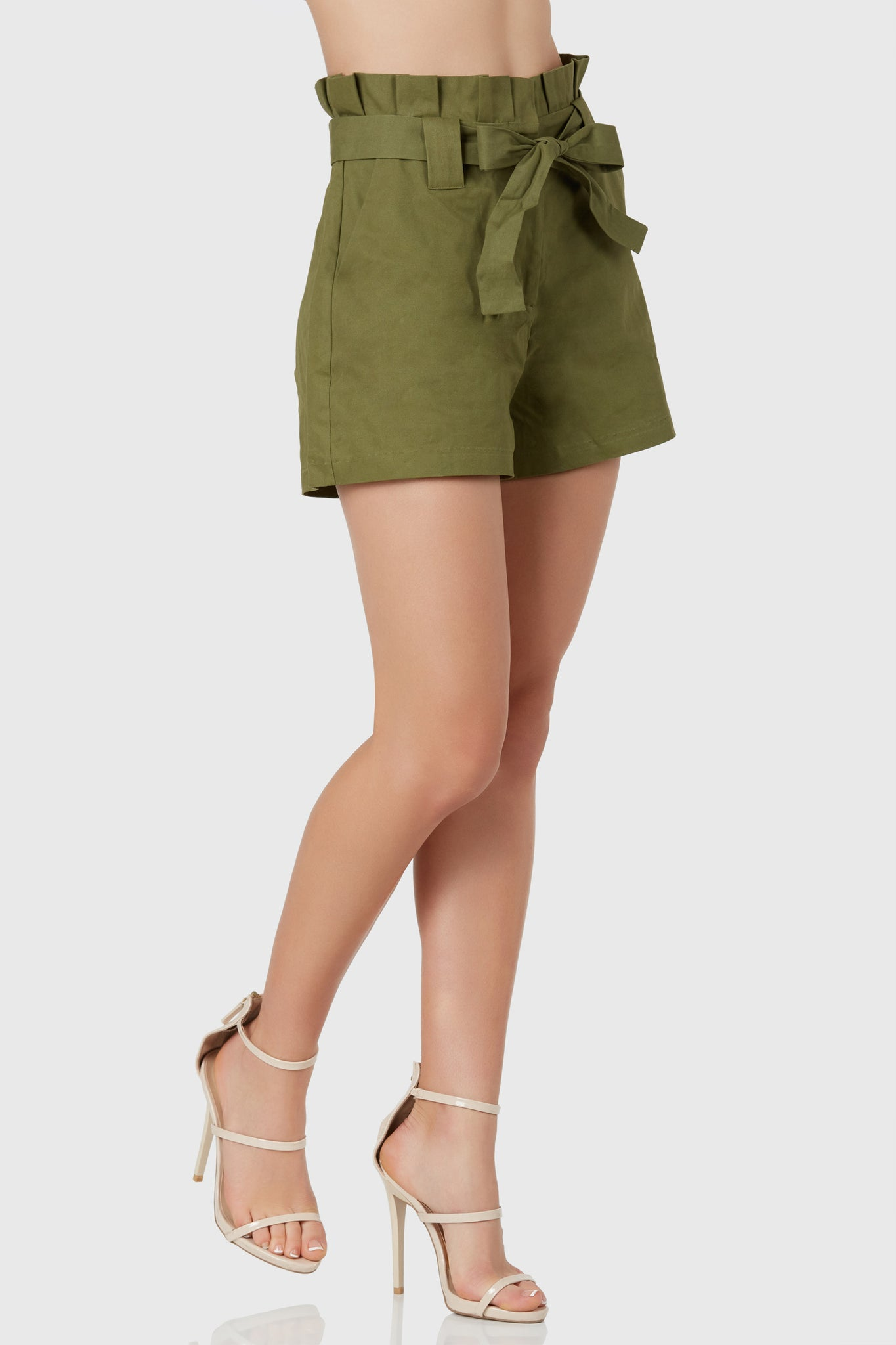 Chic high rise shorts with waist tie with cinched waist design. Side pockets with straight hem finish.