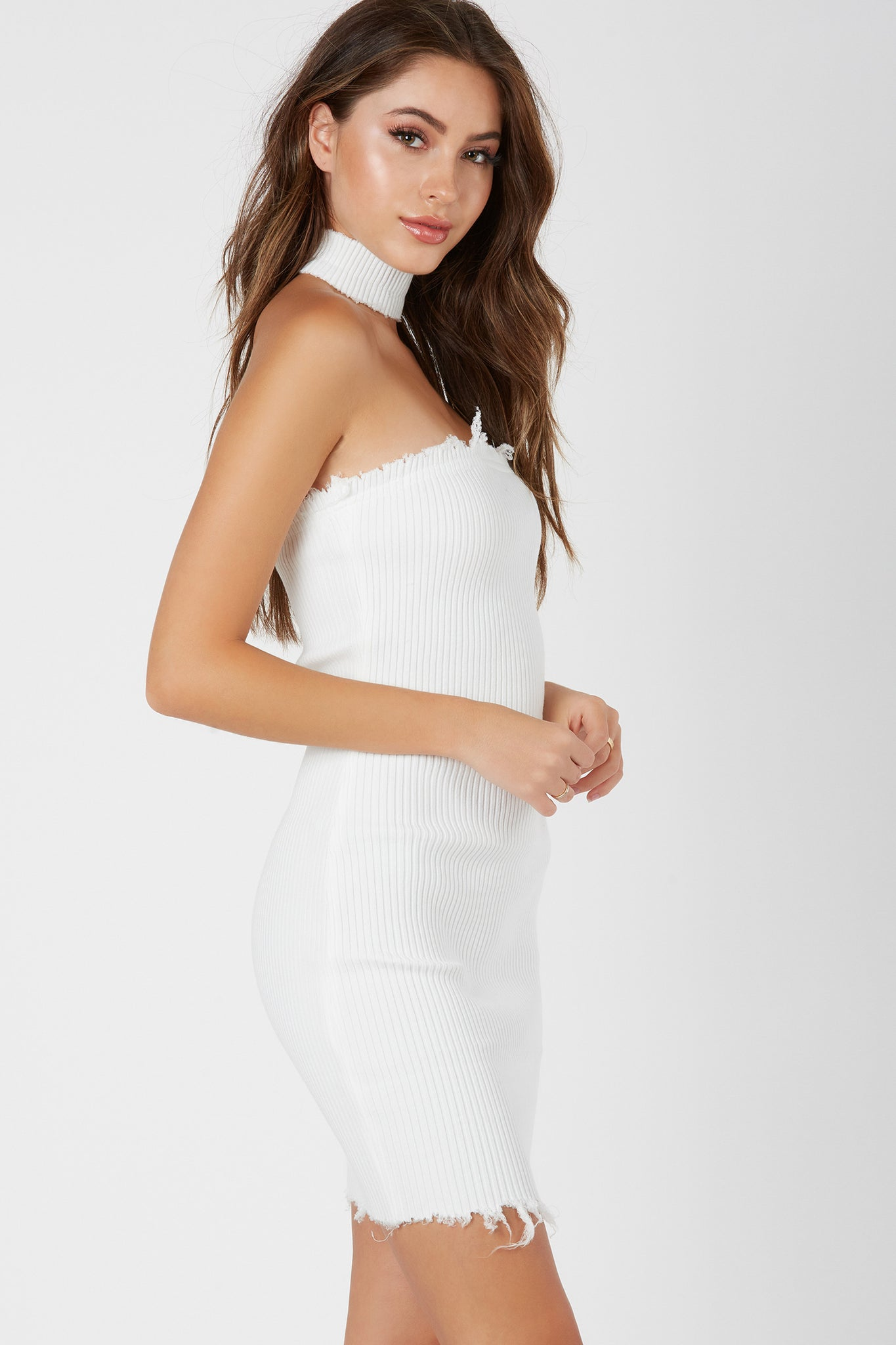 Flattering bodycon tube dress with trendy raw edge finish all around. Ribbed throughout, comes with dettached choker piece.