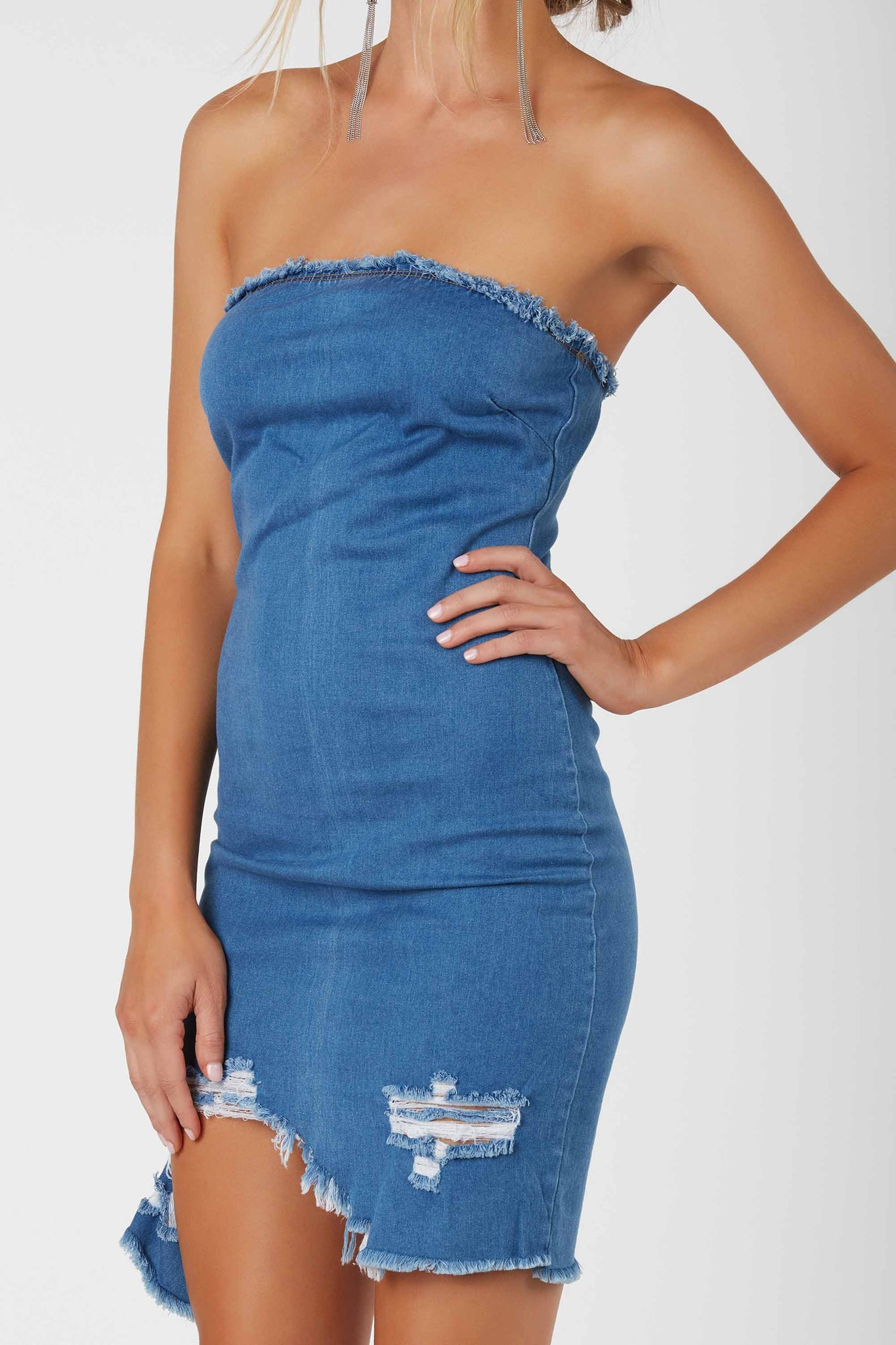 Trendy strapless tube dress with frayed raw edge finish all around. Distressed detailing and uneven hem with back zip closure.