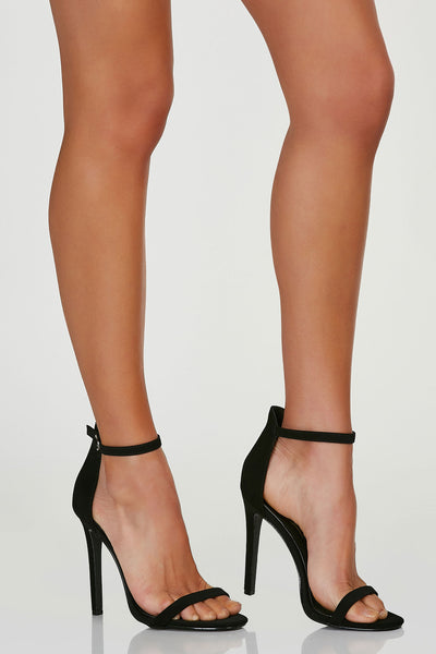 Chic two strap pumps with adjustable buckle at ankle for closure and fit. Skinny heels with soft rounded toe finish.
