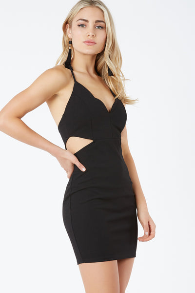 Sleeveless mini dress with scalloped V-neckline. Side cut out with hidden back zip closure.