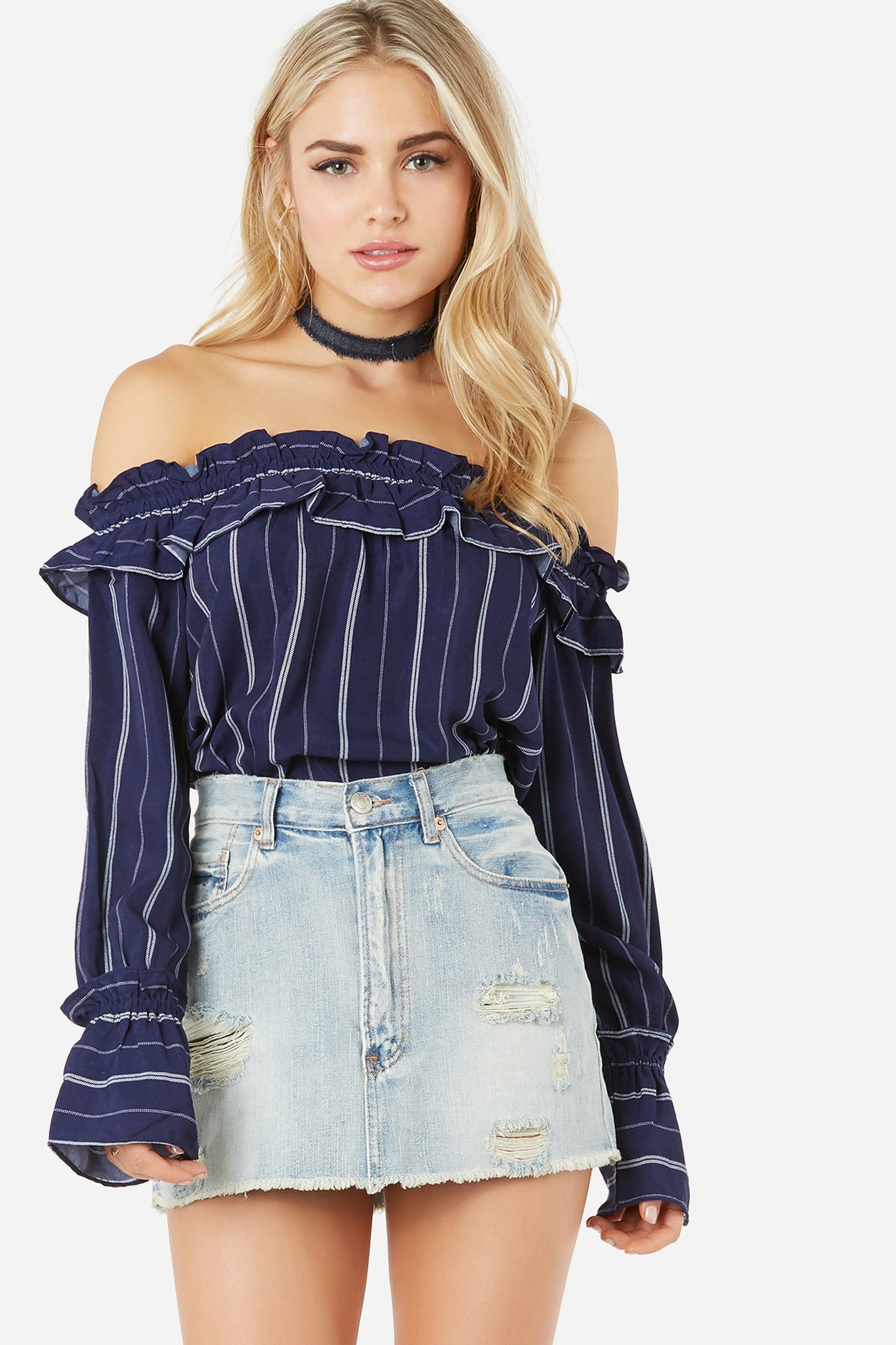 Flowy off shoulder top with stripe pattern throughout. Ruffle trim detailing with elasticized neckline.