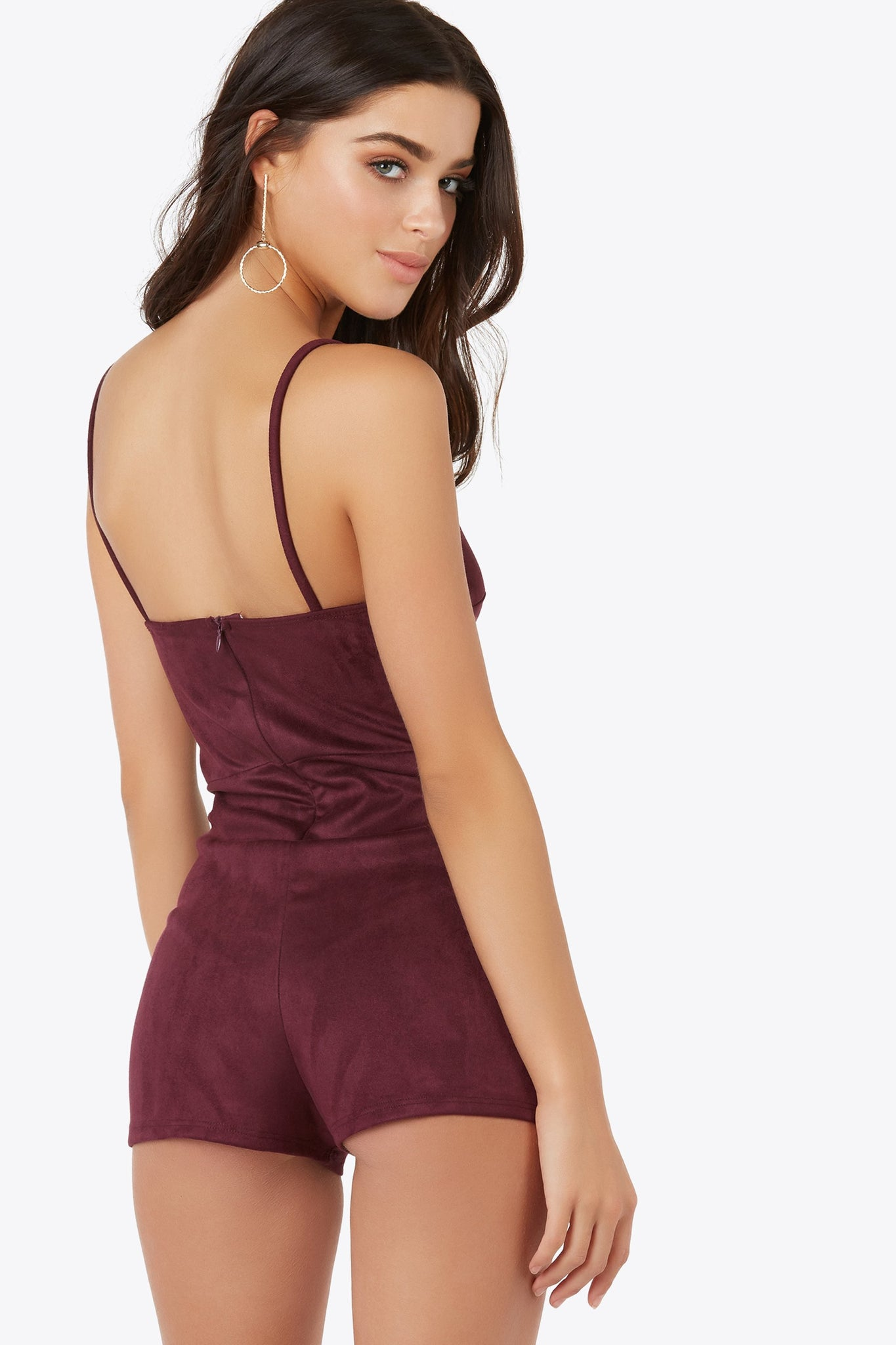 Live up the day or night in the suede-like romper with shoulder straps. Features scallop detailing on bodice and a back hidden zipper closure.
