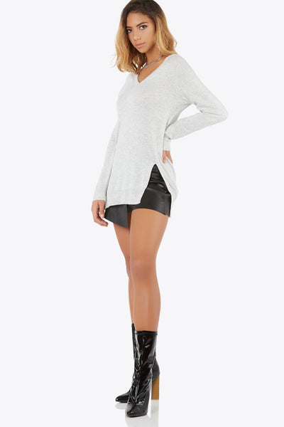 Add this knit v-neck top to your casual look. Features slit accents on side and contrast rib knit material.