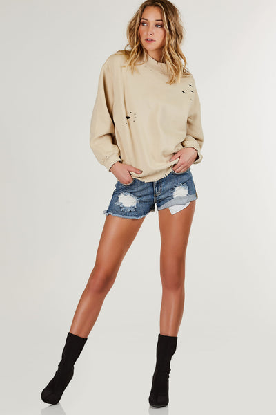 Dope oversized sweatshirt with ribbed high neck and hem all around. Trendy distressing with soft interior for warmth.