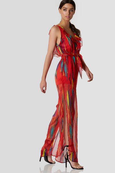 Stylish sleeveless jumpsuit with deep V-neckline and ruffle trim detailing. Colorful patterns throughout with romper lining and chiffon overlay.