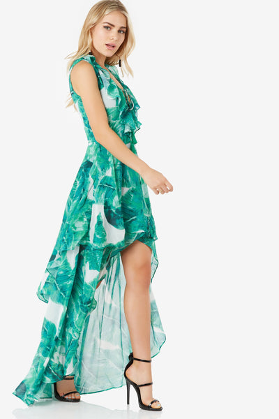 Stunning hi-low maxi dress with bold print throughout. Ruffle detailing with lace up finish at bust.