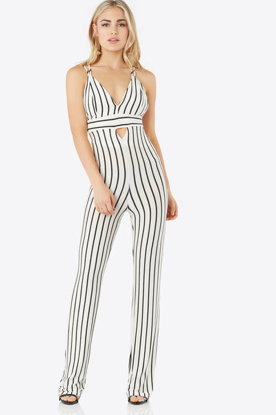 Soft V-neck jumpsuit with double shoulder straps that criss-crosses in back. Mini cut out in front with stripe pattern throughout.
