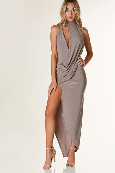 Chic mock neck sleeveless dress with asymmetrical design. One shoulder with cut out detail. Ruching off center with hi-low draped hem.