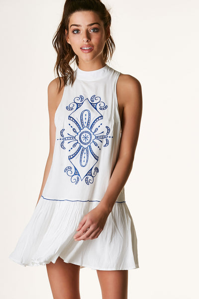Sleeveless mock neck dress with embroidery in front and back. Fuly lined with flirty A-line hem and cut out back.
