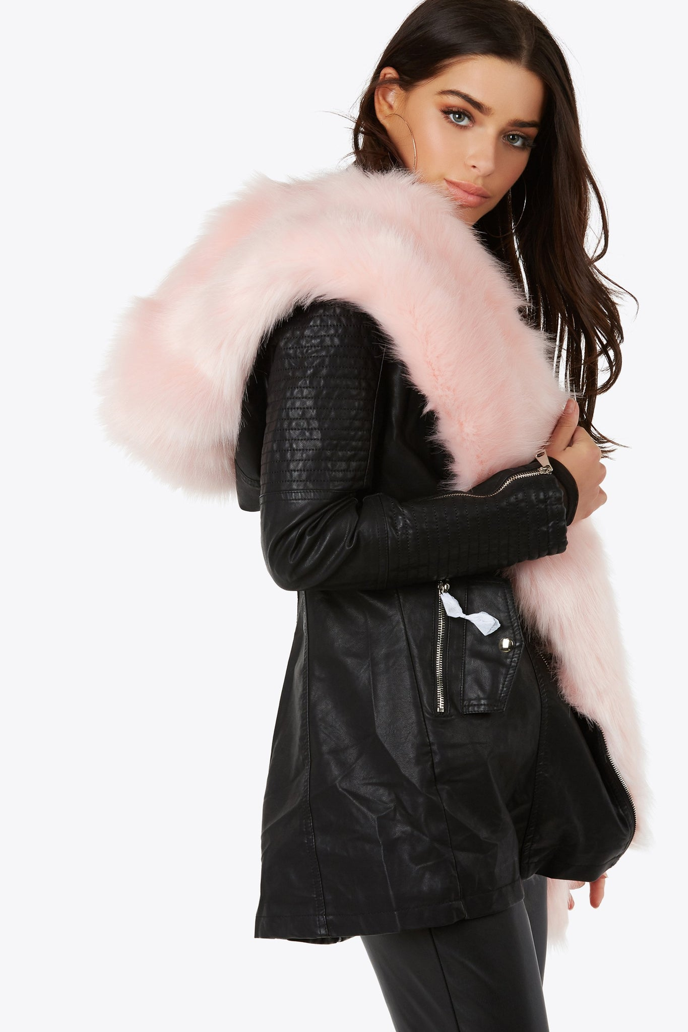 Take on the night with the fully lined vegan leather and faux fur hooded coat. Fully detachable pink fur accented trim.