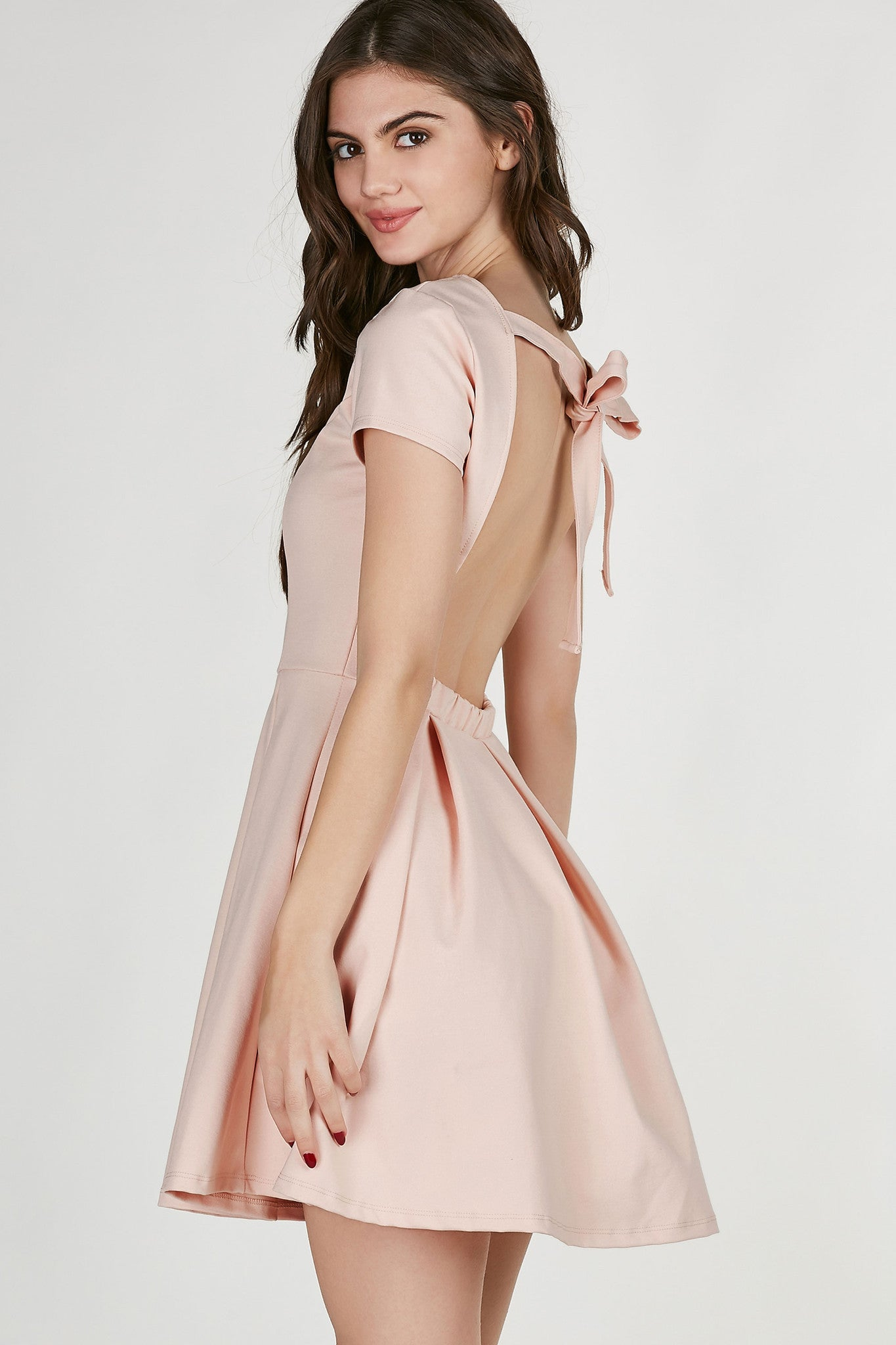 Round neck short sleeve dress with open back and tie for closure. Bold pleating at waist with A-line hem.