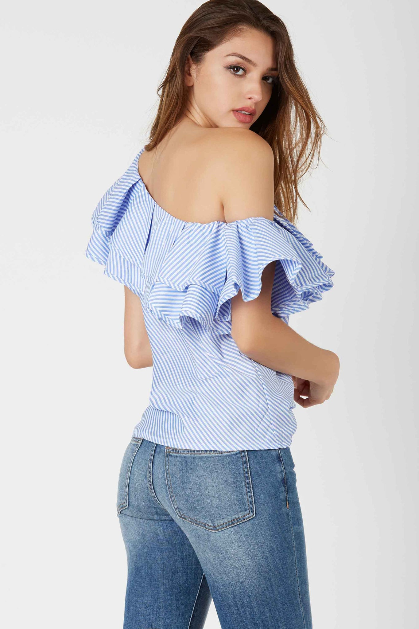 Chic one shoulder top with tiered ruffle design and stripe patterns throughout.