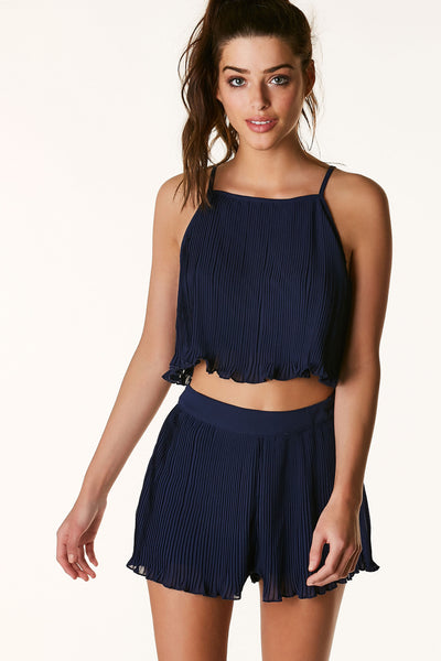 Flirty straight neck crop top, pleated throughout. Fully lined with open back with ties for closure.
