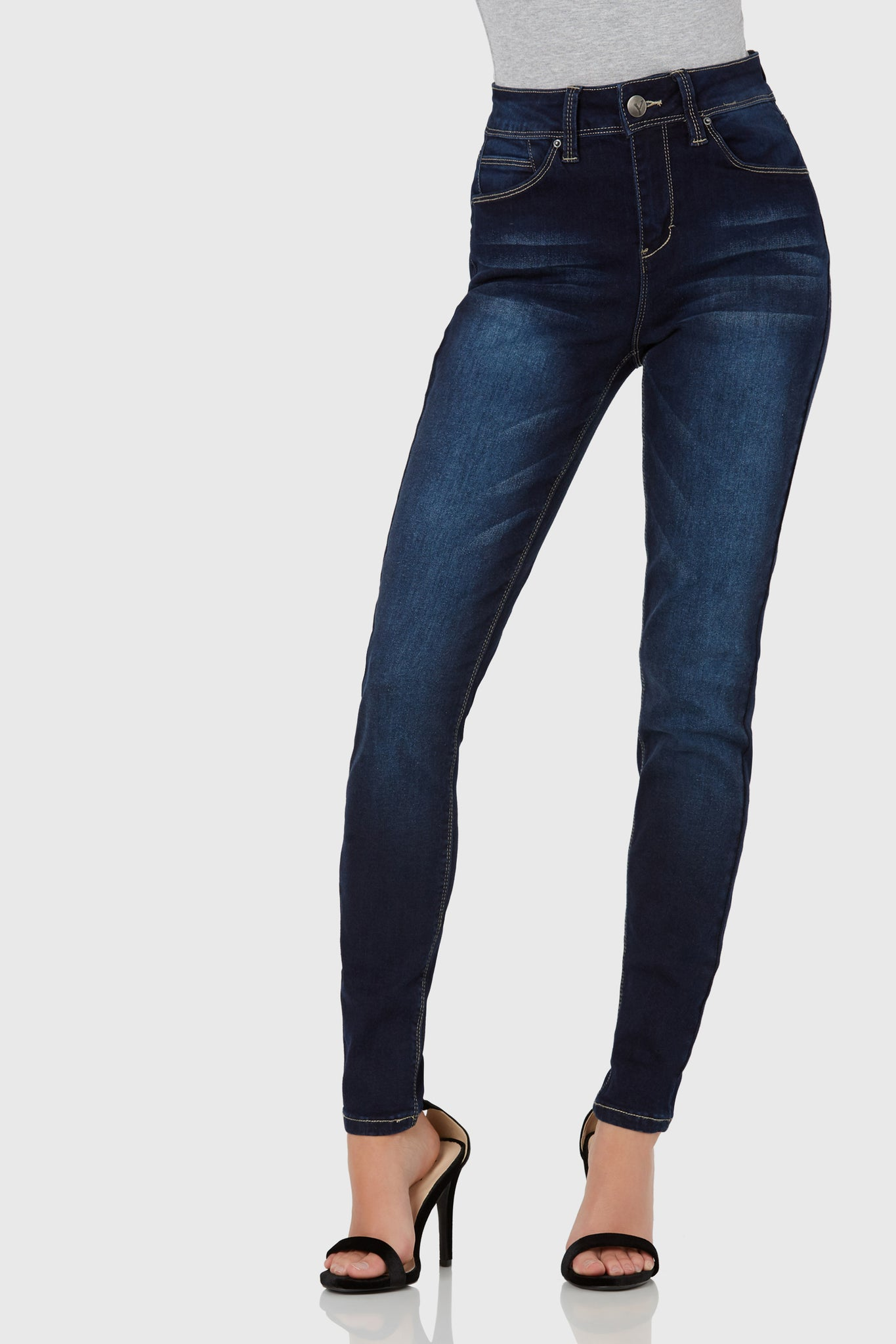 Super stretchy high rise skinnies with amazing fit and flexibility. Deep wash with front button and zip closure.